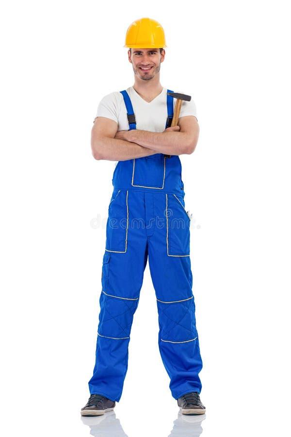 Netter männlicher Bauarbeiter stockfoto