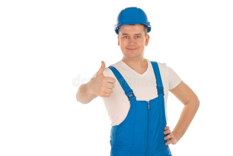 Netter männlicher Erbauer in der blauen Uniform lizenzfreies stockfoto