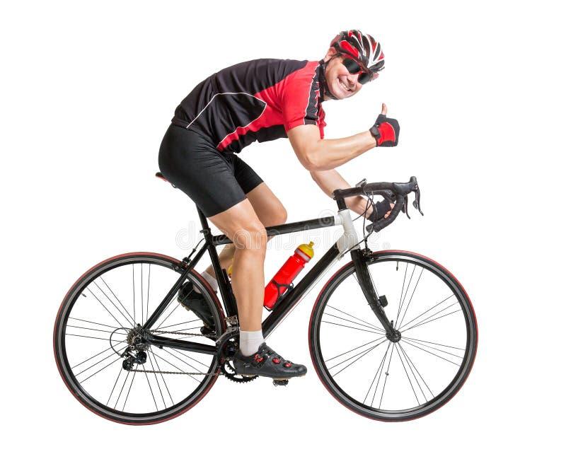 Netter Radfahrer mit dem Daumen oben lizenzfreie stockbilder