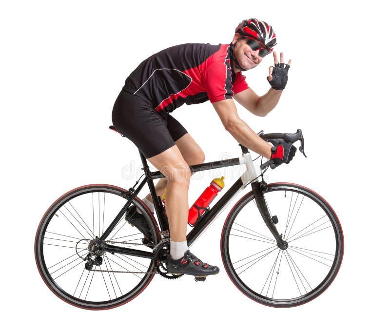 Netter Radfahrer mit gewinnender Geste stockbilder