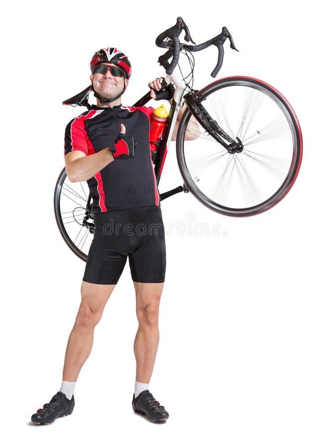 Netter Radfahrer tragen ein Fahrrad stockbilder