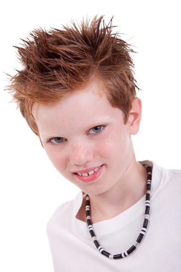 Nettes blondes Jungenlächeln lizenzfreie stockbilder