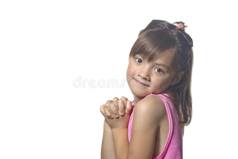 Nettes junges Mädchen mit den umklammerten Händen. stockfotografie
