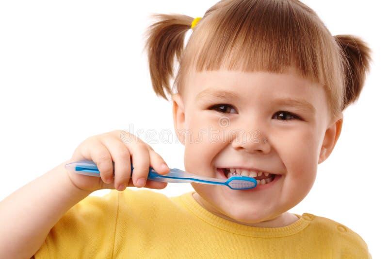 Nettes Kind mit Zahnbürste stockfotos
