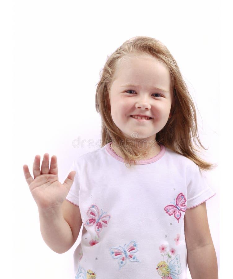 Nettes kleines Kind, das mit der Hand wellenartig bewegt lizenzfreies stockfoto