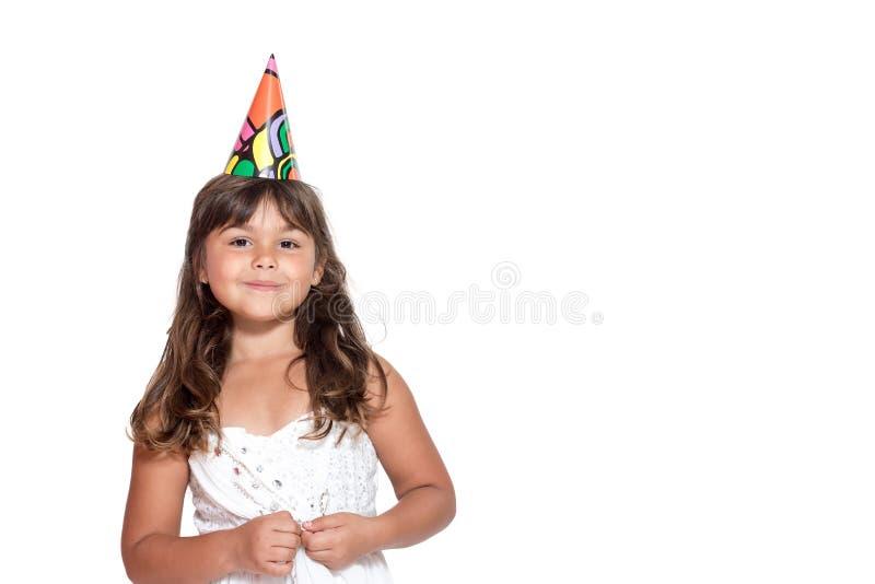 Nettes kleines Mädchen ist stehende Einfassung, welche die Kamera lokalisierte stockfoto
