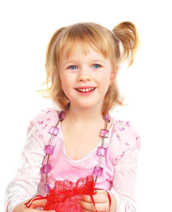 Nettes kleines Mädchen und violette Korne stockbilder