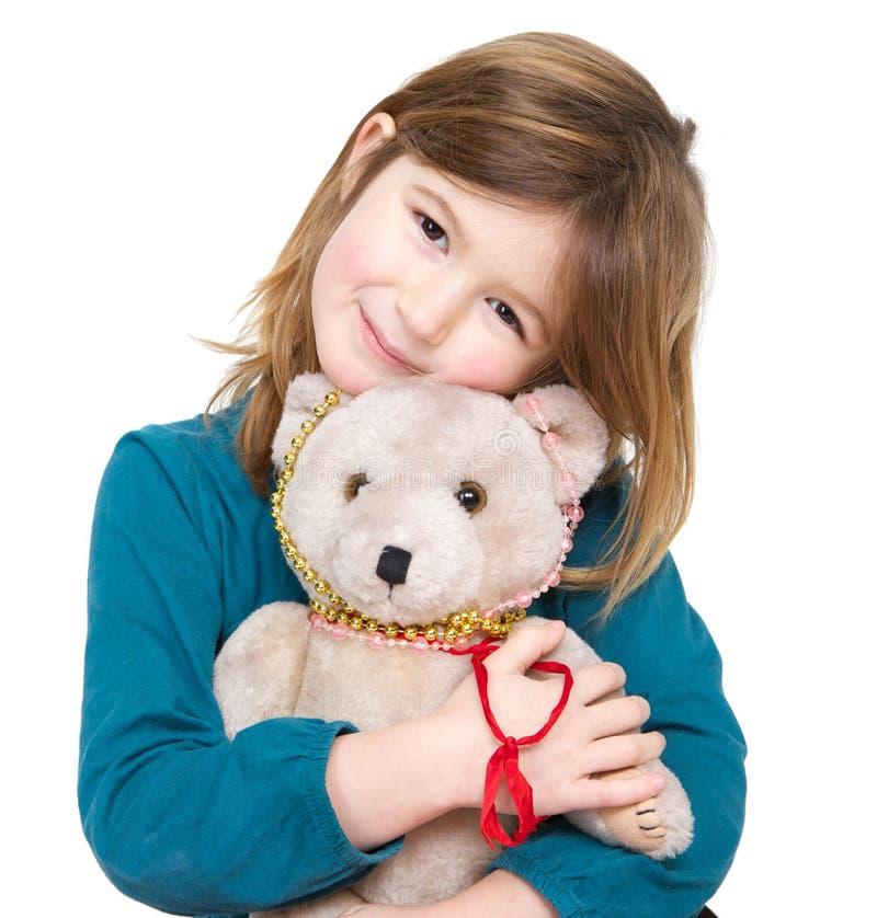Nettes Mädchen, das Teddybären hält stockbilder