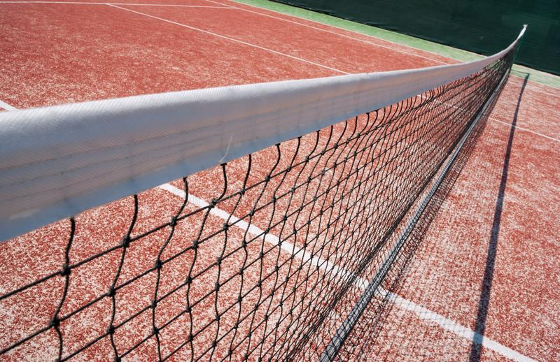 netto surface tennis f?r domstoljord royaltyfri foto