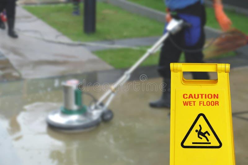 Nettoyage dans le symbole humide de plancher de processus et de précaution image libre de droits
