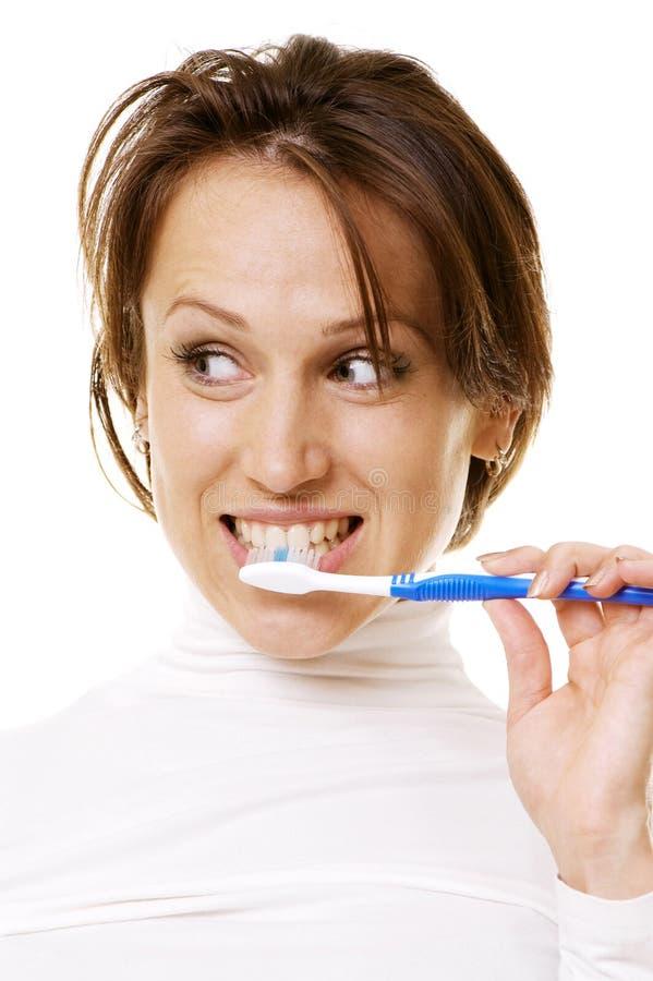 nettoyage de ses jeunes de femme de dents images libres de droits
