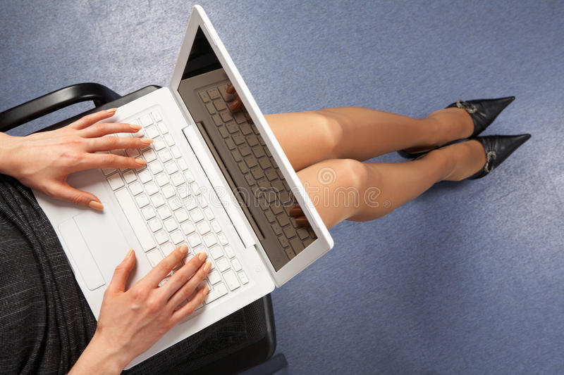 Network. Above view of businesswoman typing on laptop in office royalty free stock images