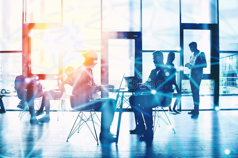 Network background concept with business people silhouette working in the office. Double exposure and network effects royalty free stock photography