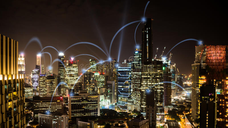 Network business conection nighttime cityscape of Singapore. Connected city concept: A wireless business network connecting offices in the business skyscrapers royalty free stock image