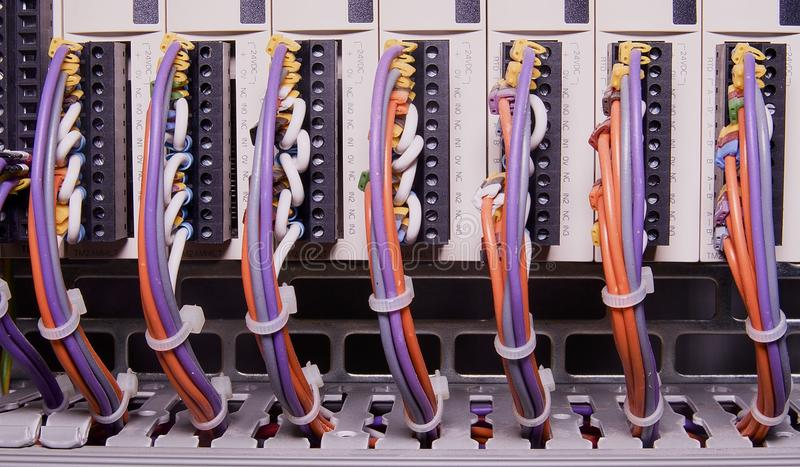 Network cables connected to switch - close up of data center hardware. Multi colored wires stock images