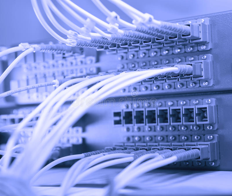 Network cables and hub. Network cables and servers in a technology data center royalty free stock images