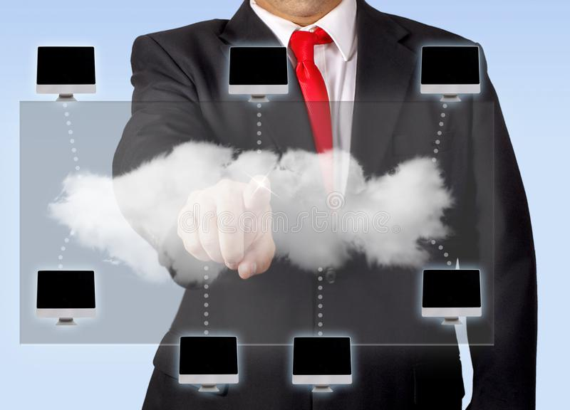 Network Cloud Computing. Man cloud computing, controlling a network of computers through a holographic screen royalty free stock images