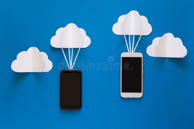 Network connection and cloud storage technology concept. Data communications and cloud computing network concept. Smart phone flying on paper cloud. Origami stock image
