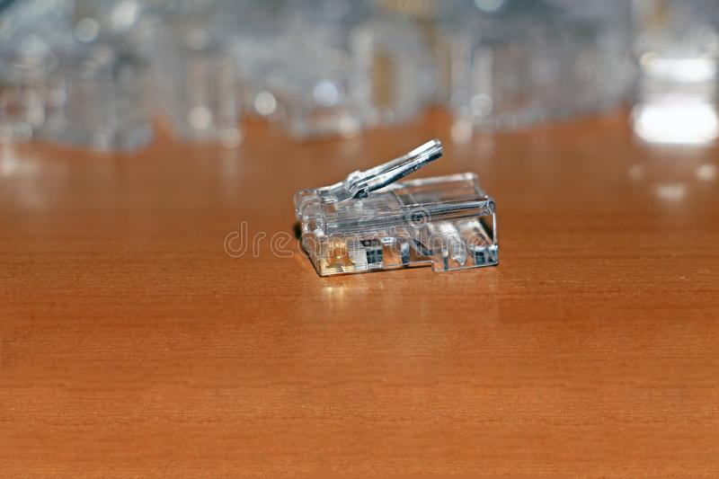 Network connector RJ-45 on a wooden table stock photography