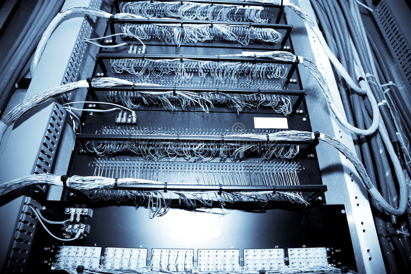 Network data center. A shot of network equipment in a data center (in blue tone