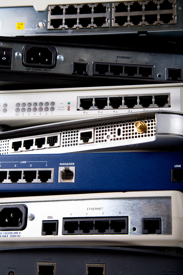 Network devices. A stack of various network devices including DSL modems, routers, hubs and switches