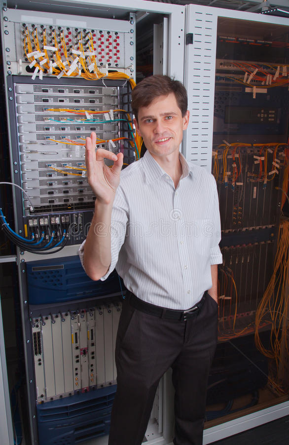 Network engineer in server room. Shows royalty free stock photo
