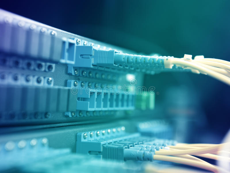 Network hub. Network and servers in a technology data center stock photo