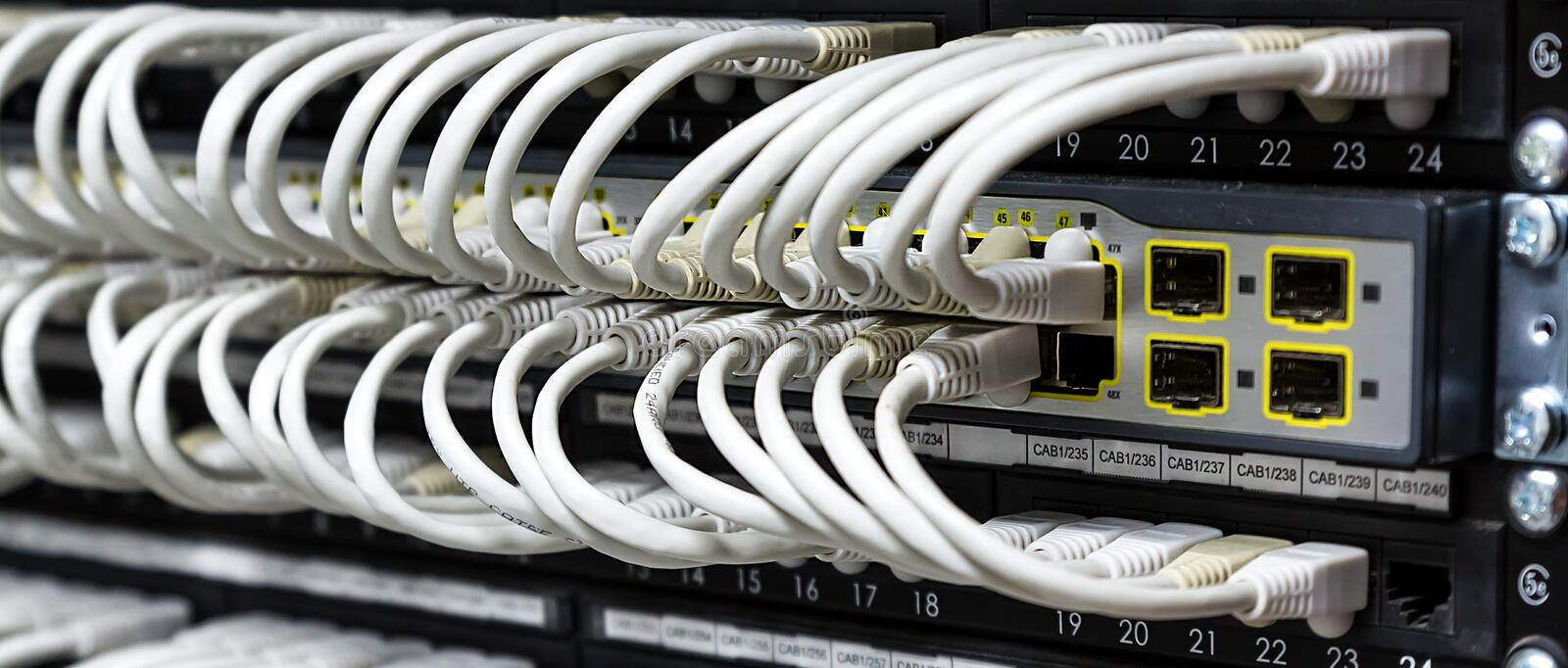 Network Hub. Closeup mage of cat5 cables in a network hub stock photos