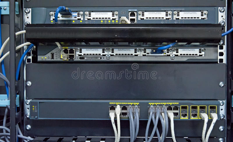 Network hub and patch cables. In network cabinet stock images