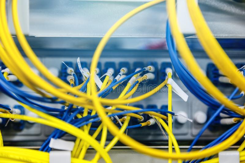 Network hub and patch UTP LAN cables in rack cabinet, close up royalty free stock images