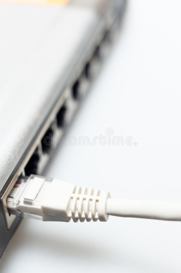 Network hub switch with lan cable connected royalty free stock images