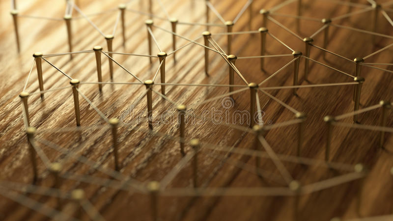 Network, networking, connect, wire. Linking entities. Network of gold wires on rustic wood. royalty free stock image