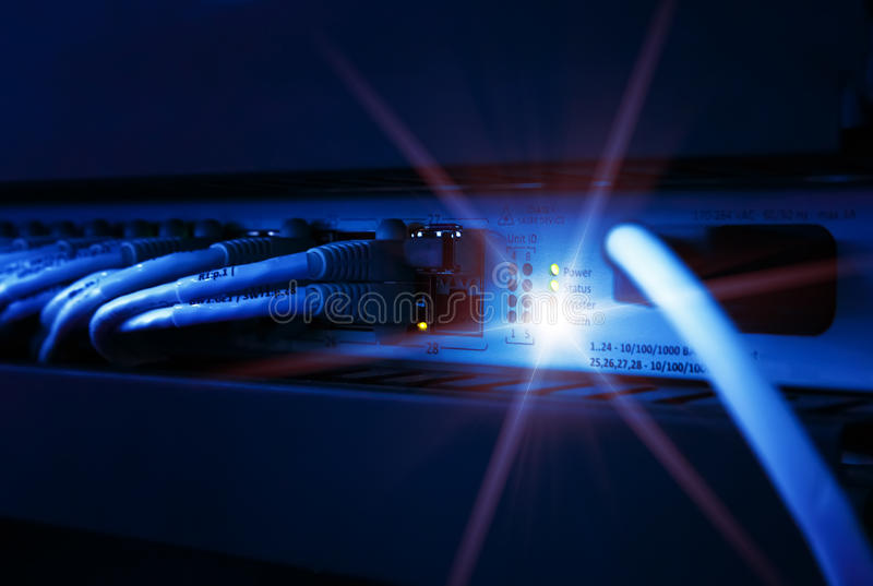 Network panel, switch and cable in data center stock photos