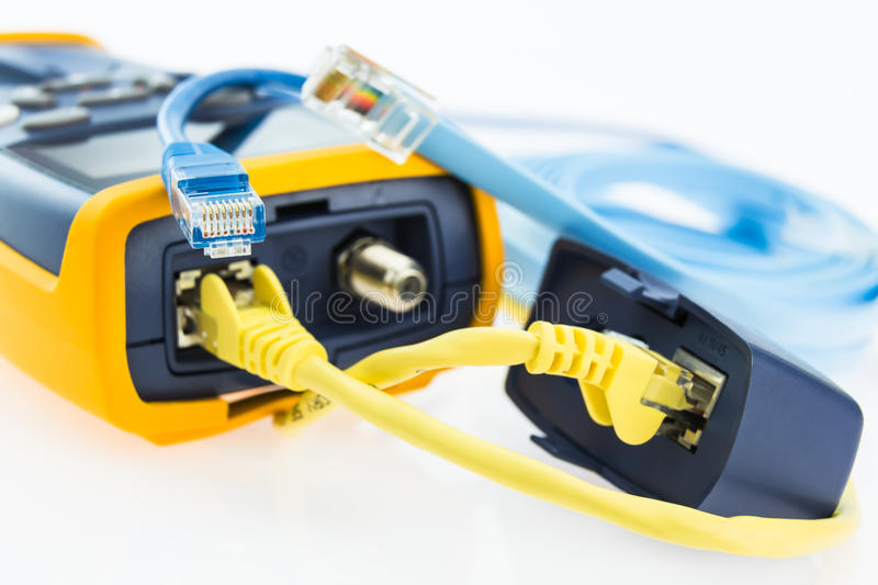Network RJ45 cable tester and a few various cables royalty free stock photography