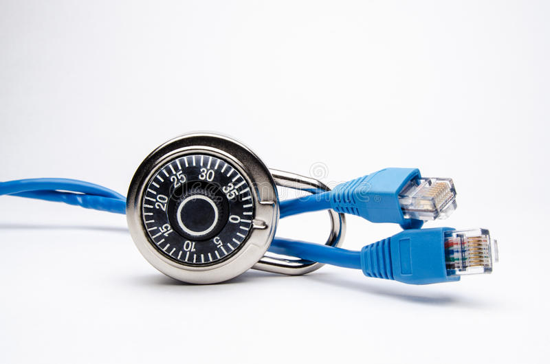 Network Security with Combination Lock on Side. Combination lock on its side with 10-baseT ethernet cable running through lock. On white royalty free stock image