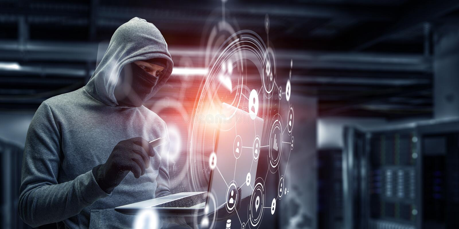 Network security and privacy crime. Mixed media. Computer hacker in hoodie and mask stealing data from laptop. Mixed media royalty free stock images
