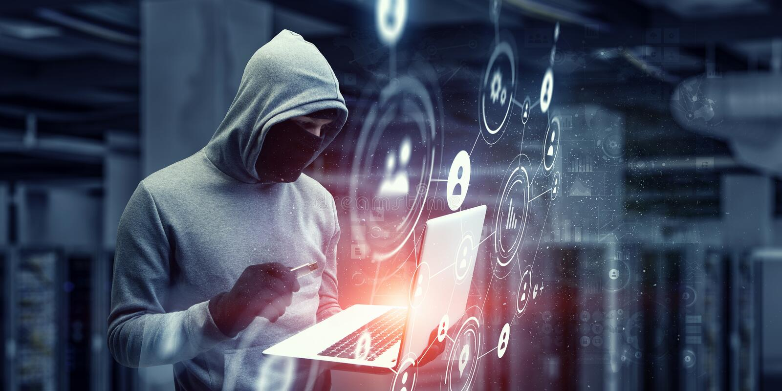 Network security and privacy crime. Mixed media. Computer hacker in hoodie and mask stealing data from laptop. Mixed media stock image