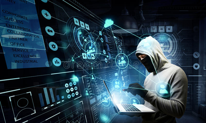 Network security and privacy crime. Mixed media. Computer hacker in hoodie and mask stealing data from laptop. Mixed media stock photos
