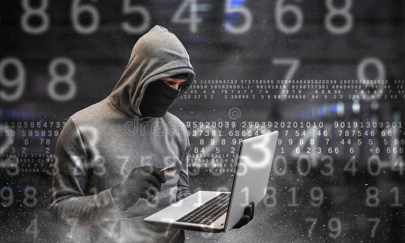 Network security and privacy crime. Mixed media. Hacker man with laptop in hands stole some information on flash. Mixed media royalty free stock photo