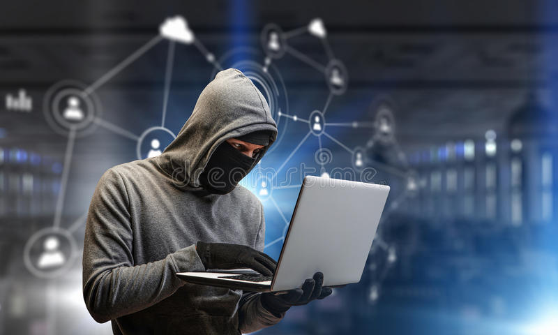 Network security and privacy crime. Mixed media. Hacker man with laptop in hands stole some information on flash. Mixed media stock image