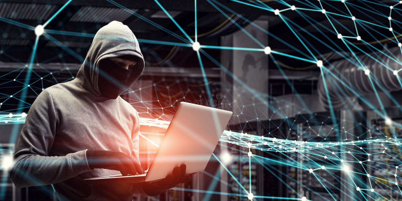 Network security and privacy crime. Mixed media . Mixed media. Computer hacker in hoodie and mask stealing data from laptop. Mixed media stock photos