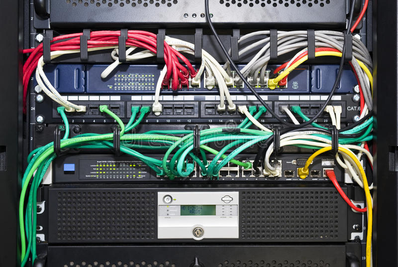 Network server cable management. The color coded and neatly bracketed cables for network and telecommunications in an high tech server configuration