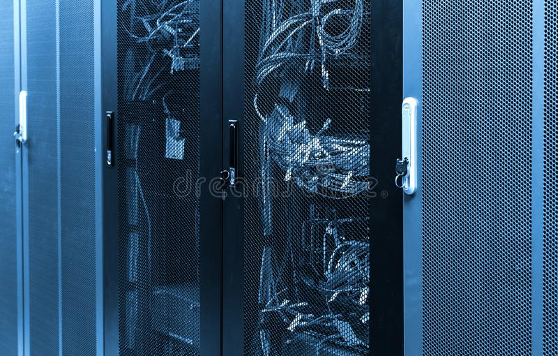 Network server panel with ethernet cable on switches in school system stock photo