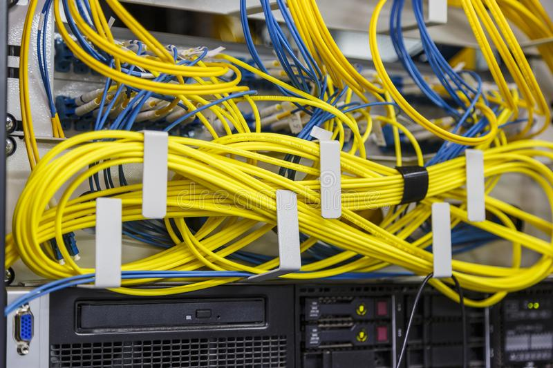 Network server room routers with fusebox panel. Neatly twisted wires. Datacentre interface and equipment. Network and technology stock photography