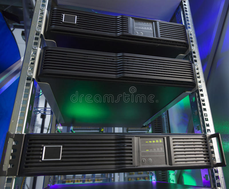 Network servers in a data center. Control modules heat power. Network servers in a data center stock photography