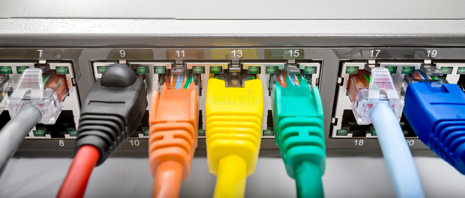 Network Switch with cables. Network ethernet switch with connected cables stock photos