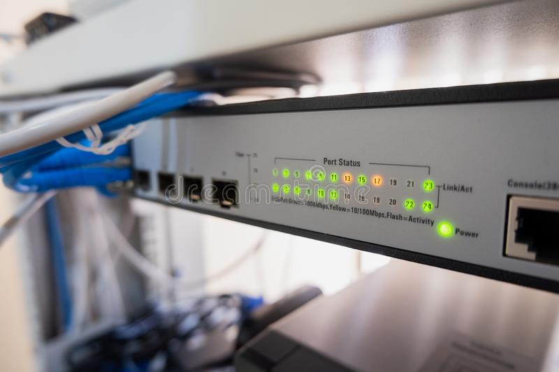 Network switch LED show online green and orange status royalty free stock photo