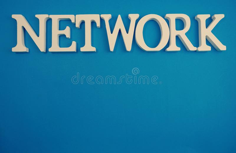 Network word alphabet letters on blue background stock photo