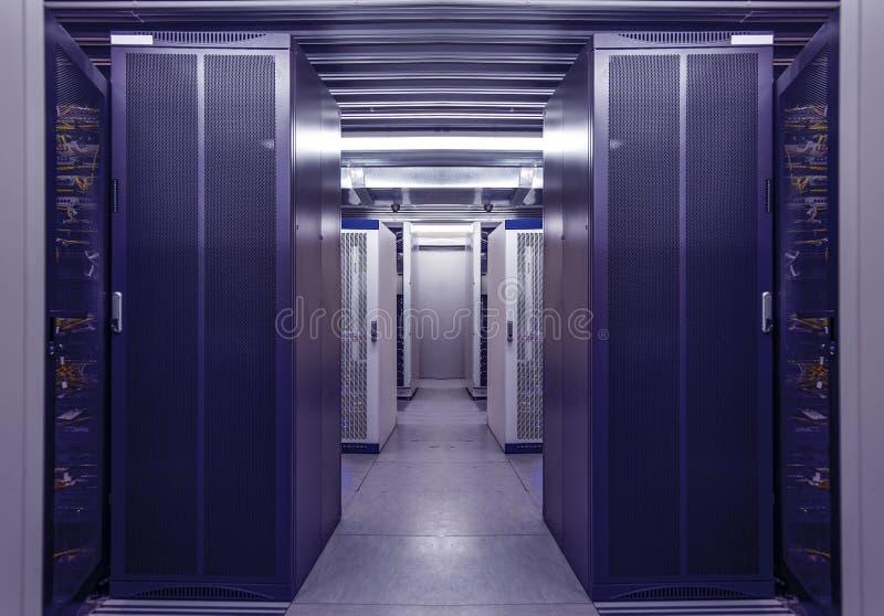 Network workstation blue server room interior in data centre. Web telecommunication, internet connection, cloud. Network workstation server room interior in data stock image