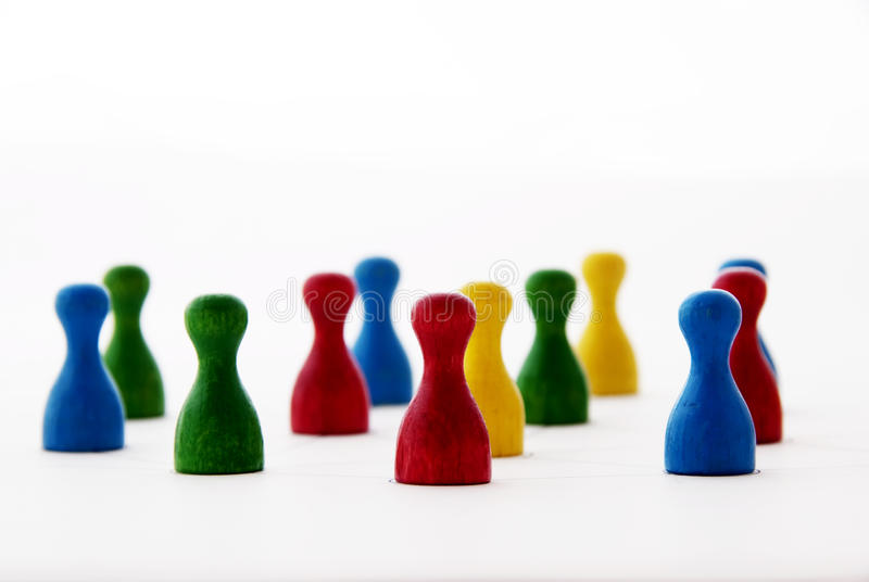 Networking. Concept with colorful wooden people or checkers - , organizational groups, or workgroups - Business concept - the focus is on red people group stock photo